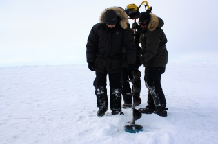 Andy, Kyle and Craig prepare to finish drilling a hole in the ice.