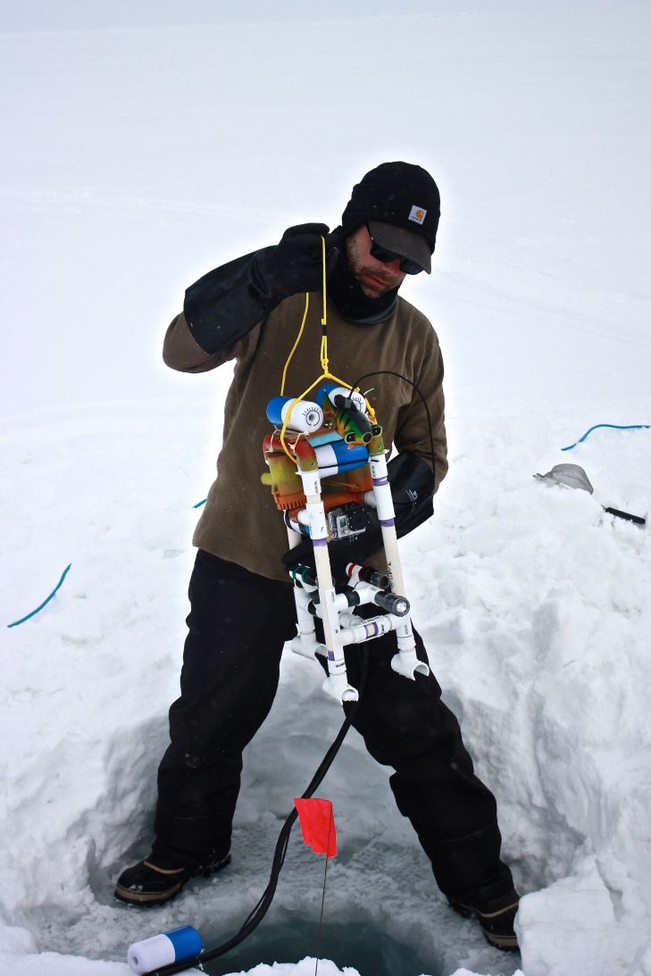Scientist Andy Juhl readies Brinson, a remotely operated vehicle, for a voyage into the Arctic Ocean.